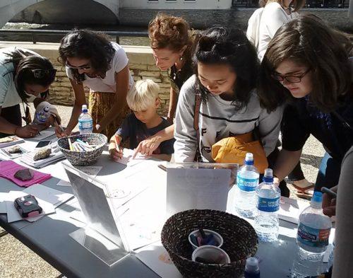 Community members making at at Riverfront Fine Arts Festival